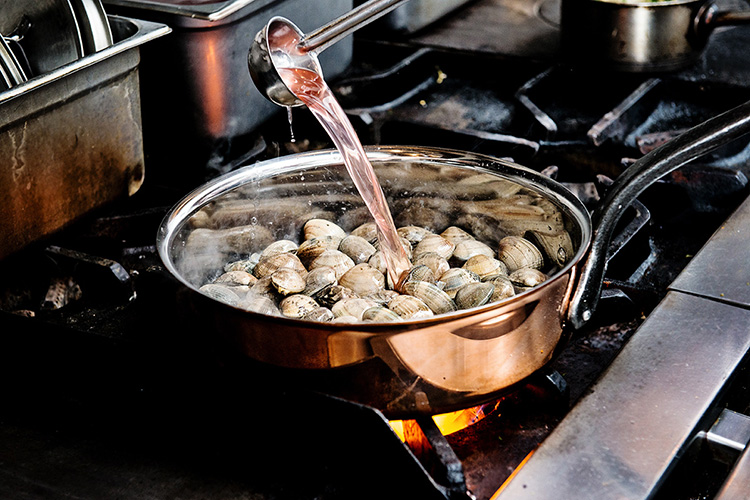 Chef Eric Greenspan creates delicious clam and pasta dish with Matfer Bourgeat's Copper Saute Pan for chef spotlight.