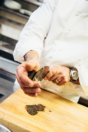 Matfer's Truffle Cutter in the hands of Josiah Citrin who is creating an increadible Oeuf Mollet Frit in his kitchen at Melisse.