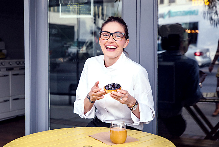 Chef Waylynn Lucas laughs while holding her tart