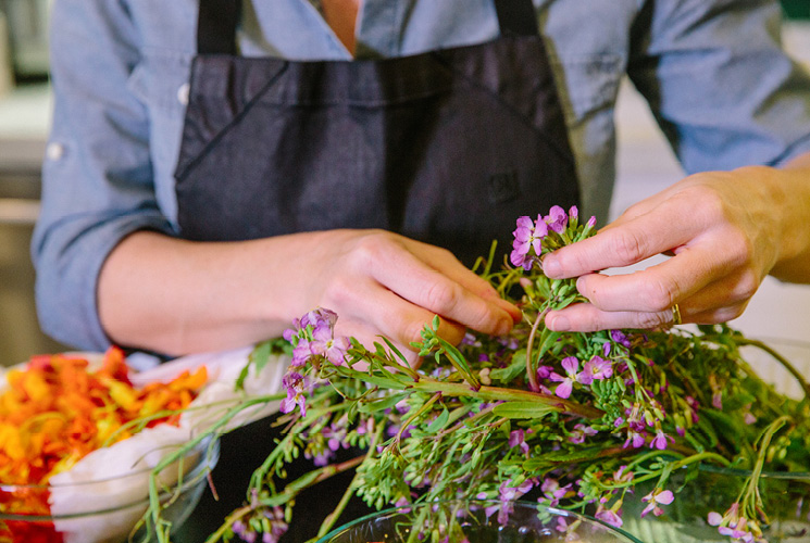 Chef Casey Thompson picking her edible flowers