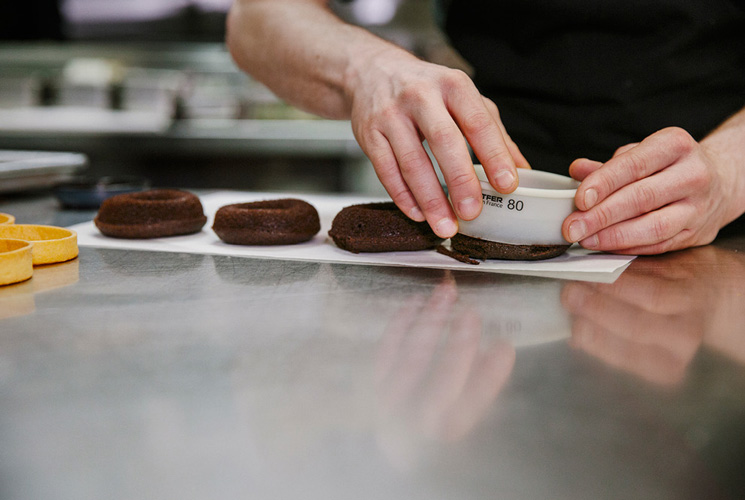 Zac Young makes coffee and donut tart